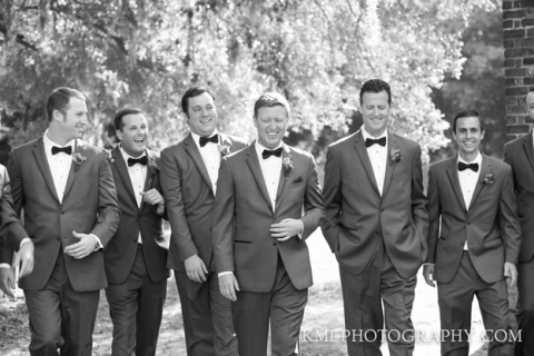 groom and groomsmen gathered for wedding in Wilmington NC