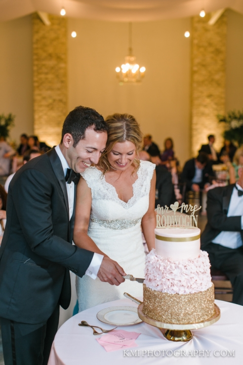 the bride and groom cut the cake at wrightsville manor