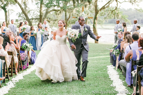 the joyful bride and groom after their wedding in wilmington nc with photography by kmi photography