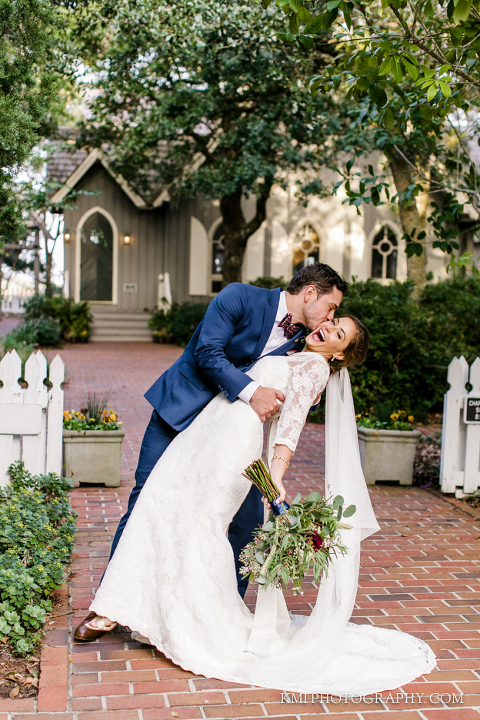 the bride and groom in front of the Bald Head Island Chapel