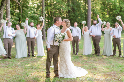 the wedding party celebrates at the barn at rock creek with photography by kmi photography