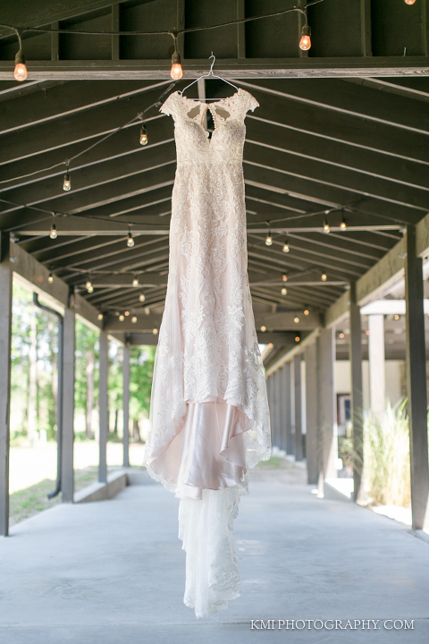 the brides dress hung at the barn at rock creek and photography by kmi photography