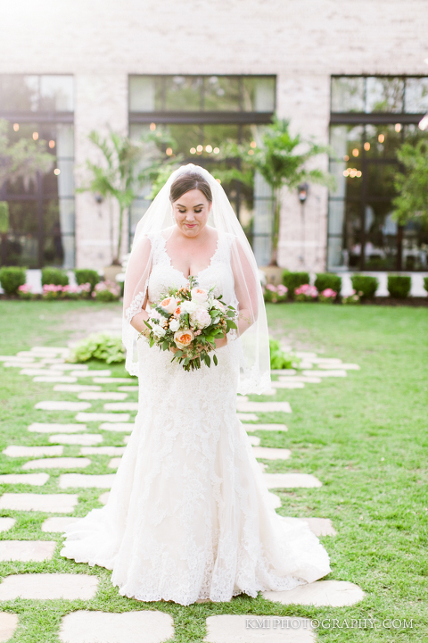 a bride is photographed in front of wrightsville manor