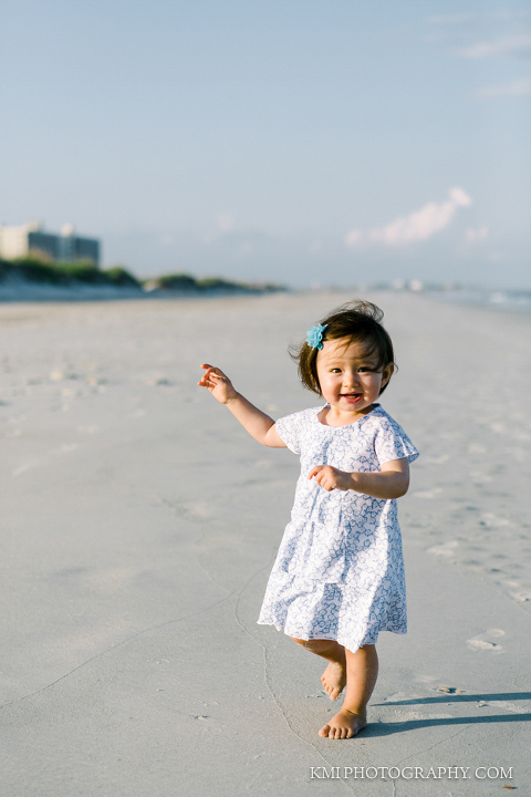 a child plays at Wrightsville Beach during a family session