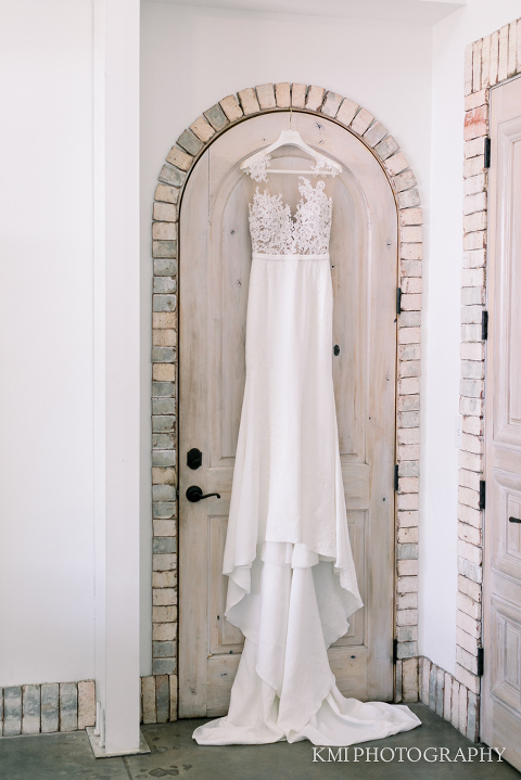 a wedding dress hangs at Wrightsville Manor